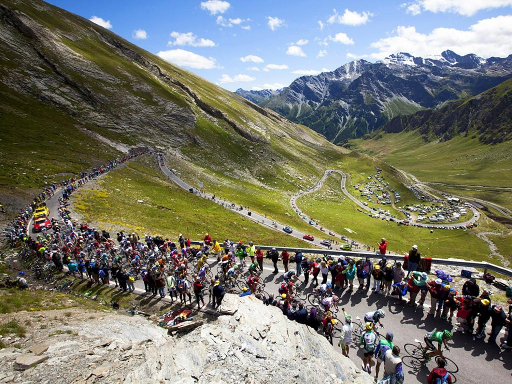 Power Through Riders ascend the Haute Catergorie climb of the Col Agnel on stage 18 of the Tour de France in Galibier, France. Mike Powell 01